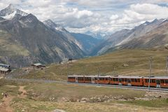 Gornergrat train with tourist is going to Matterhorn mountain. Zermatt, Switzerland - June 24, 2017: Gornergrat train with tourist is going to Matterhorn stock photos
