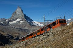 Gornergratbahn. A train on the Gornergrat bahn in front of the famous Matterhorn. Zermatt, Switzerland stock photo