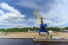 Gorodets, Russia. - June 2.2016. Blue portal crane with a yellow arrow on the cargo wharf in Gorodets about Gateway. Stock Images