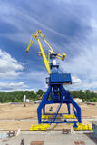 Gorodets, Russia. - June 2.2016. Blue portal crane with a yellow arrow on the cargo wharf in Gorodets about Gateway. Stock Photos