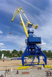 Gorodets, Russia. - June 2.2016. Blue portal crane with a yellow arrow on the cargo wharf in Gorodets about Gateway. Royalty Free Stock Image