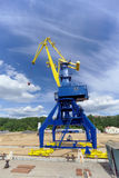 Gorodets, Russia. - June 2.2016. Blue portal crane with a yellow arrow on the cargo wharf in Gorodets about Gateway. Stock Photography