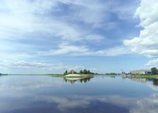 Gorodets,, Russia. - June 2.2016. Mayak Gorodetsky gateway on the Volga River. Reflection of clouds in water. Royalty Free Stock Image