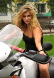 Sexy woman on motorcycle Royalty Free Stock Photo