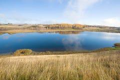 Gorodischenskoe lake in the golden autumn. Izborsk, Russia. Gorodischenskoe lake in the golden autumn. Izborsk. Russia Royalty Free Stock Photo