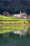 Goroeta village with reflections, in Urkulu reservoir Stock Photography