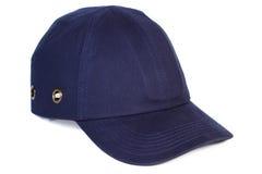 Gorra de béisbol de los azules marinos en el fondo blanco, protección contra el sol Fotografía de archivo libre de regalías