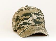 Gorra de béisbol modelada camuflaje Fotografía de archivo libre de regalías