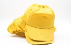 Gorras de béisbol amarillas Imagen de archivo libre de regalías