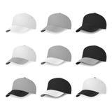 Gorras de béisbol bicolores en media vuelta con los colores blancos, grises y negros Fotografía de archivo
