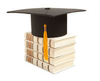 Gortarboard and book Royalty Free Stock Photos