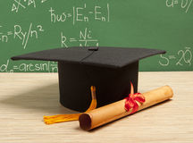 Gortarboard and graduation scroll Stock Image