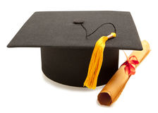 Gortarboard and graduation scroll Royalty Free Stock Image