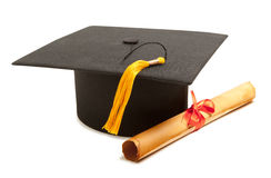 Gortarboard and graduation scroll Royalty Free Stock Photo