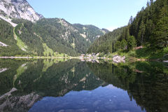 Gosau. No wind in the mountain area. Reflection on Gosau lake Royalty Free Stock Photography