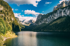 Gosausee lake against blue sky and clouds, Salzkammergut Stock Photos
