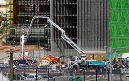 Gosford Hospital building progress December 18, 2018. h76ed. Gosford, New South Wales, Australia - December 18, 2018: Pumping concrete with safety netting stock photography