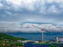 Gosford Hospital building progress H55ed October 2018. Gosford, New South Wales, Australia - October 20, 2018: Storm cloud over construction and building site on royalty free stock images