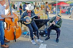 Gosford City Farmers Market Day April, 2017. Gosford, New South Wales, Australia - April 30, 2017: Gosford City Farmers Markets, featuring their three musicians stock photo