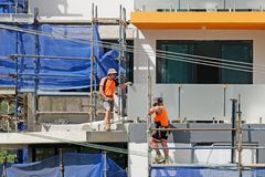 Construction Workers on site at 47 Beane St. Gosford. March, 2019. Building update 205. Gosford, New South Wales, Australia - March 6, 2019: Workmen close up stock photography