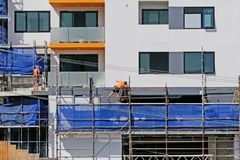 Construction Workers on site at 47 Beane St. Gosford. March, 2019. Building update 206. Gosford, New South Wales, Australia - March 6, 2019: Workmen dismantling stock images