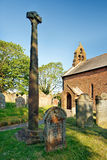 Gosforth ancient Viking Cross. Gosforth wheel head cross, the tallest Viking cross in England erected in the year 940, can be found in St Mary's churchyard Royalty Free Stock Photos