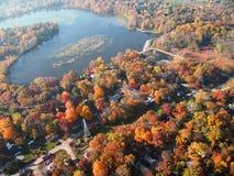 Goshen Pond and neighborhood. Aerial photograph at peak fall foliage colors. Goshen Pond (Indiana) and surrounding neighborhood royalty free stock image