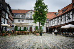 Goslar square with cafes - copple stone. One of many cosy squares in the old medieval town of Goslar - a beloved place for tourists and locals to enjoy a coffee Royalty Free Stock Images