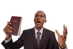 The Gospel. This is an image of man holding a bible. This image can be used to represent sermon, preaching etc stock photo