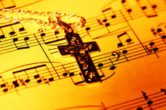 Gospel. Crucifix and Sheet Music Stock Photography