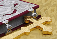 Gospel and cross. Orthodox cross and the gospel  prepared for ceremony the consecrations Stock Photo
