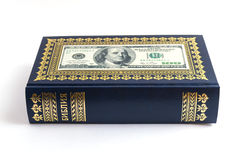 The gospel of Franklin. Dollars on the Bible on a white background Stock Photo