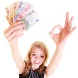 Gospodarka finanse Kobieta trzyma euro waluta pieniądze Fotografia Stock