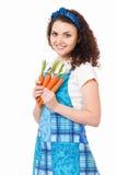 Gospodyni domowa z świeżymi marchewkami Obraz Stock