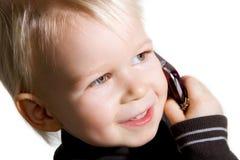 Gosse au téléphone image libre de droits