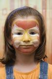 Gosse avec le visage coloré par réception Image stock