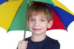 Gosse avec un parapluie Photos libres de droits