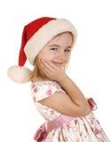 Gosse de Noël dans le chapeau de Santa Images stock