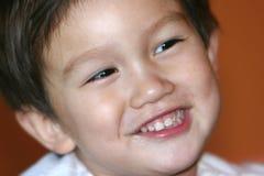 Gosse de sourire Photographie stock