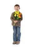 Gosse heureux avec des tulipes Photos libres de droits