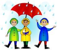 Gosses avec un parapluie Image libre de droits