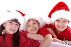 Gosses dans des chapeaux de Santa Photographie stock libre de droits
