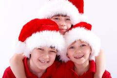 Gosses de chapeau de Santa images libres de droits