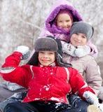 Gosses en hiver Photos libres de droits