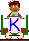 Gosses et séries de train - K Photos libres de droits