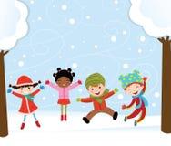 Gosses heureux en hiver Images stock