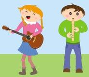 Gosses jouant des instruments Image libre de droits