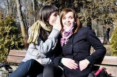 Gossip. Two teenage girls sharing a secret Royalty Free Stock Photo