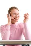 Gossip. Young women is talking on the mobile phone laughing Royalty Free Stock Photos