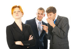 Gossip. Two men are whispering behind the back of a colleague Stock Photography